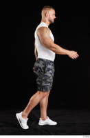 Grigory  1 camo shorts dressed side view sports walking white sneakers white tank top whole body 0005.jpg
